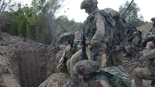 IDF soldiers standing over the entrance to an uncovered terror tunnel. Credit: IDF spokesman.