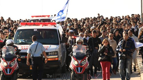 Photos credit: Hillel Maeir, Tazpit News Agency. Photo 1: ambulance transporting the bodies to burial. in the background, thousands of israelis which attended the funerals.