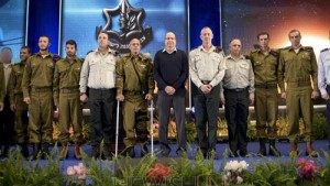 Sahar Elbaz award: IDF Chief of Staff Benny Gantz (6R) and Defense Minister Moshe Boogie Yaalon (7R) with Sahar Elbaz (4L) and other Israeli soldiers during a grant decorations, citations ceremony at the Palmachim Airbase on Feb 2, 2015. Photo by IDF Spokesperson