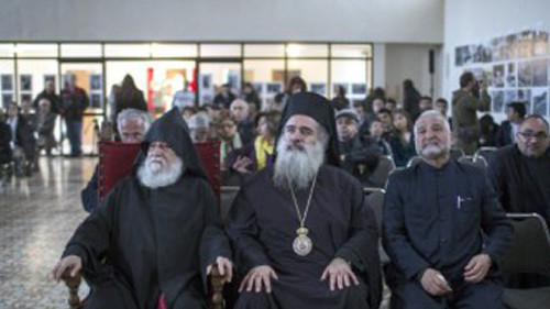 Armenian Archbishop Sevan (R) sits next to Greek Bishop Atallah, as they watch a live screening from Echmiadzin, Armenia, of the Church canonization of the genocide victims as saints, in the Armenian Quarter of Jerusalem's Old City. Photo Credit: Hadas Parush/Flash90